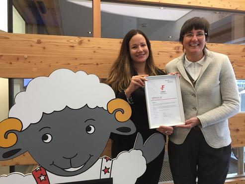 "The two representatives of Zermatt Tourism with the label ""Family Destination"" given by the Swiss Federation of Tourism STV. Left Viktoria Cristiano from the work group ""Families"" and Doris Aufdenblatten, accommodation. With Wolli, Zermatt's mascot for children."