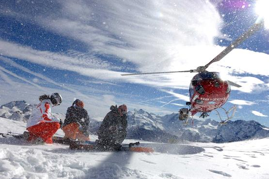 Soft landing: The Air Zermatt helicopter drops off skiers at the summit.