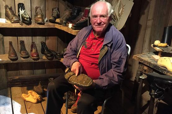 Otto Burgener made hundreds of pairs of mountain boots and ski boots over his lifetime. He points out the